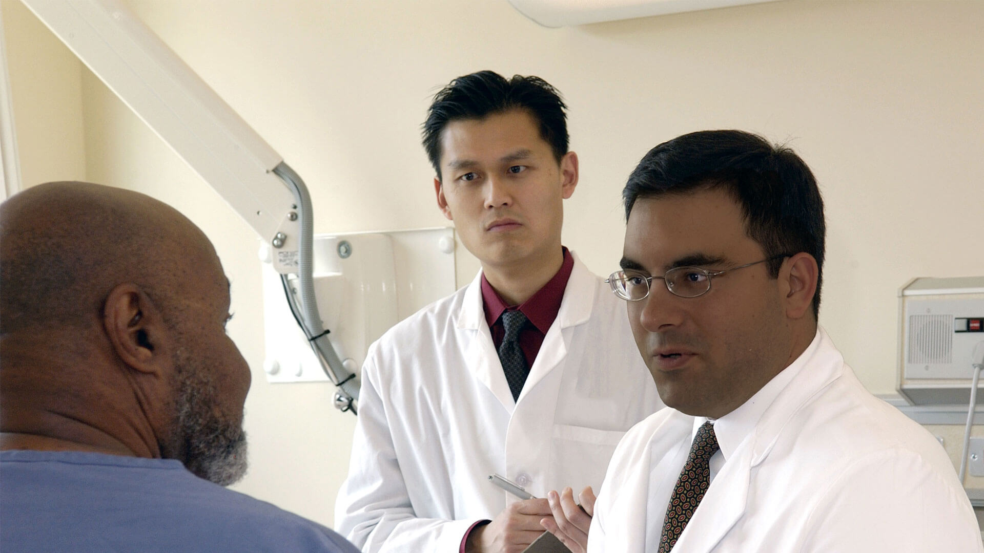 Doctors in a room with patient